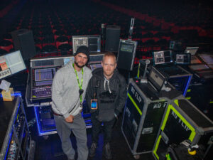 Post Malone FOH Engineer Joseph Hellow (left) and Playback Engineer Willie Linton (right) at the Runaway Tour's FOH position, equipped with DiGiCo SD5 and SD10 mixing consoles and L-Acoustics 108P nearfield monitors