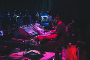 Engineer Anthony Branch working on a DiGiCo SD12 for a session by the artist Pink Sweat$ at Sixth Sense Creative House